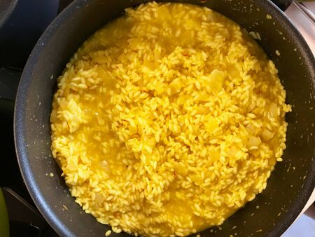 Italian Risotto with Saffron in Pan  Alla Milanese Style. Traditional Food.