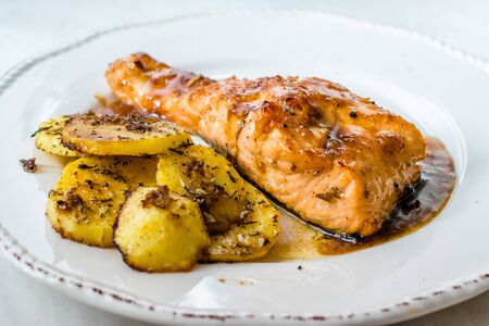 Grilled Salmon with Honey Glaze, Burnt Butter and Baked Potatoes. Ready to Serve Stock Photo