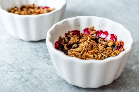 Crumble with Fresh Berries, Oatmeal, Nut, Flax Seeds and Granola. Organic Dessert. Stock Photo - 128992782