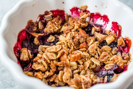 Crumble with Fresh Berries, Oatmeal, Nut, Flax Seeds and Granola. Organic Dessert. Stock Photo - 128992898