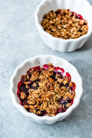 Crumble with Fresh Berries, Oatmeal, Nut, Flax Seeds and Granola. Organic Dessert. Stock Photo