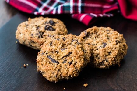 Paleo Chocolate Chip Cookies Made with Coconut and Almond Flour on Dark Wooden Board. Organic Snacks. Stock Photo