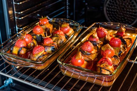 Turkish Islim Kofta Kebab with Meatballs and Cherry Tomatoes Wrapped in Eggplant / Aubergine Slices on Oven Tray. Traditional Food.