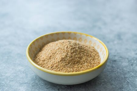 Bread Crumbs / Rusk Powder in Porcelain Bowl. Organic Food. Archivio Fotografico