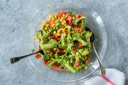 Broccoli Salad with Red Pepper and Corn in Glass Bowl. Organic Food.
