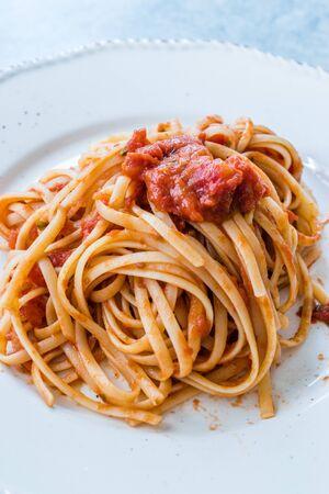 Heaped Plate of Classic Italian Pasta Spaghetti with Basil and Tomato Sauce. Traditional Organic Food.