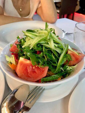 Turkish Season Salad Mevsim Salatasi with Tomatoes and Cucumber Slices at Restaurant. Organic Food. Reklamní fotografie