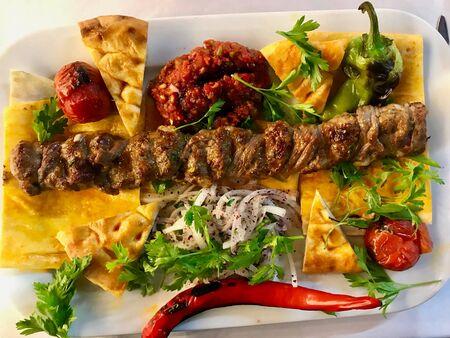 Turkish Adana  Urfa Kebab Topkapi and Pide Lavash served with Kebap Plate at Restaurant. Traditional Minced Meat Food.