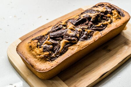 Whole Marble Cake on Wooden Board. Ready to Serve. Traditional Dessert.