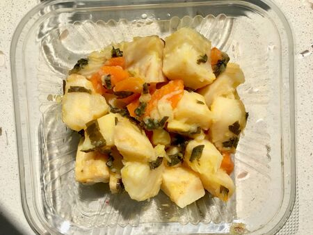 Turkish Olive Oil Food Celery Salad with Carrot and Parsley in Plastic Box, Container or Package  Zeytinyagli Kereviz. Organic Food.