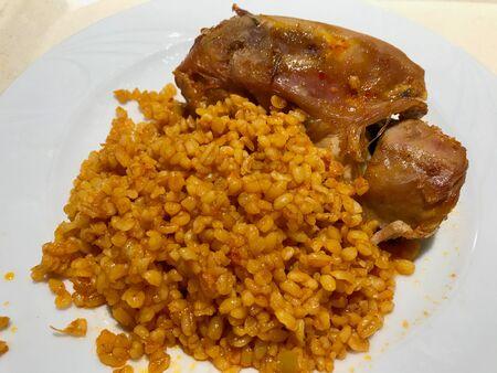 Turkey Meat with Bulgur  Bulghur Rice Pilav or Pilaf in Plate at Restaurant. Organic Food Restaurant. Reklamní fotografie