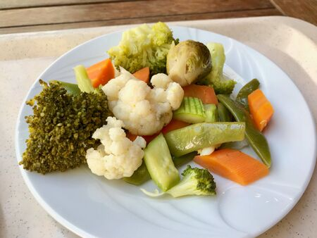 Healthy Organic Boiled Mixed Vegetables Cauliflower, Broccoli, Carrot and Brussels Sprout in Plate as Appetizer Plate. Ready to Serve. Reklamní fotografie