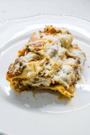 Lasagna with Minced Meat Beef and Bechamel Sauce in Plate.  Classic Italian Organic Dish.