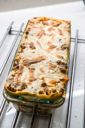 Lasagna with Minced Meat Beef and Bechamel Sauce in Glass Bowl. / Classic Italian Organic Dish.