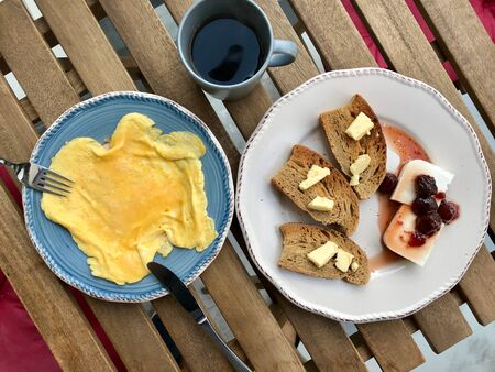 Breakfast Plate with Omelette, Toast Bread Butter , Cottage Cheese, Strawberry Jam  Marmalade and Filter  Filtered Coffee. Organic Food.