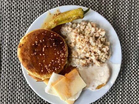 Breakfast Plate with Pancake Sesame Honey, Milk Oat, Green Pepper Slice and Creamy Cheese. Fast Food.