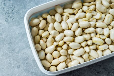 Organic Unsalted White Peeled Raw Peanuts in Plastic Box Container  Package. Organic Food.