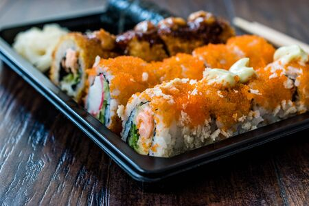 Sushi Set in Plastic Container Box  Package. California Roll, New York Roll, Boom Roll, Ginger, Wasabi and Soy Sauce. Traditional Food. Reklamní fotografie