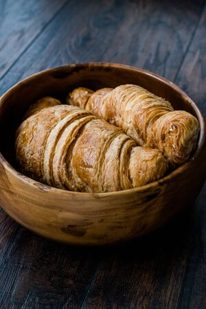 Freshly Baked Croissants in Wooden Bowl. Bakery Concept.
