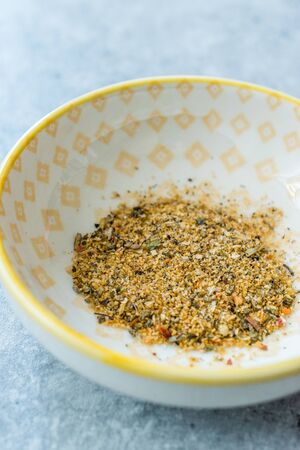 Dry Organic Adobo Pork Seasoning in a Bowl  Dried Spices. Ready to Eat and Use.