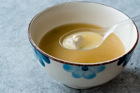 Japanese Food Miso Soup with Tofu and Seaweed in Ceramic Bowl. Фото со стока