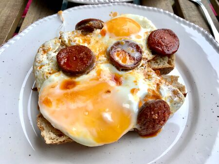 Turkish Breakfast Sucuk with Fried Eggs  Salami or Sujuk. Traditional Food at Local Restaurant.