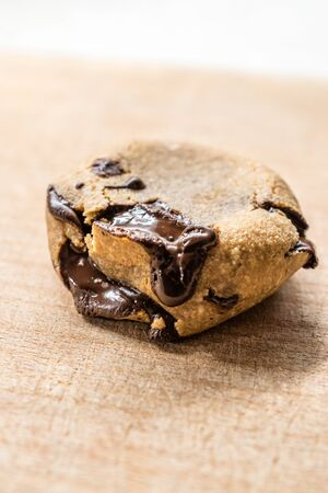 Paleo Chocolate Chip Cookies Made with Coconut and Almond Flour on Wooden Board.