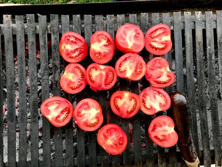 Half Cut Grilled Tomatoes on Barbecue. Organic Food.