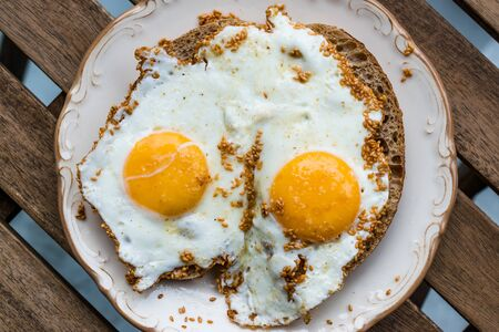 Fried Eggs with Sesame Seeds on Bread for Breakfast. Organic Food.