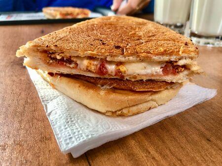 Turkish Utu Tost  Toast Sandwich on Wooden Table Surface. Street Food. Street Food.