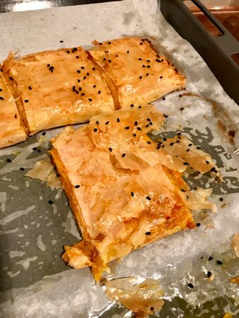 Turkish Pastry Borek with Pumpkin and Cumin Seeds on Baking Paper