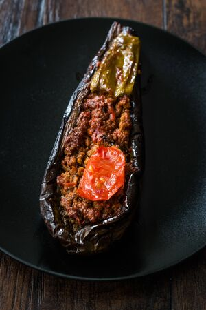 Karniyarik - Stuffed Eggplants, Aubergines with Ground Beef and Vegetables Baked with Tomato Sauce. Traditional Organic Food.