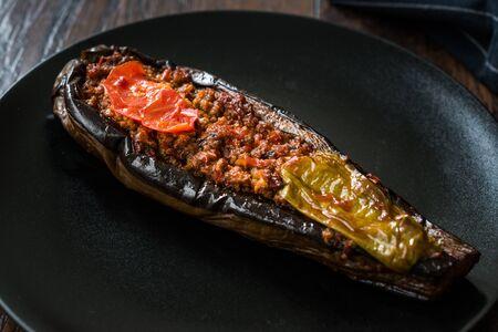 Karniyarik - Stuffed Eggplants, Aubergines with Ground Beef and Vegetables Baked with Tomato Sauce. Traditional Organic Food.