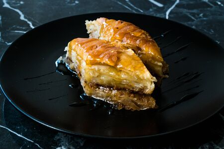 Homemade Turkish Dessert Organic Baklava with Honey. Traditional Food.