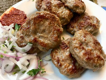 Turkish Meatballs Kofte  Kofta with Onions and Red Hot Chili Tomato Paste Sauce served with Plate.