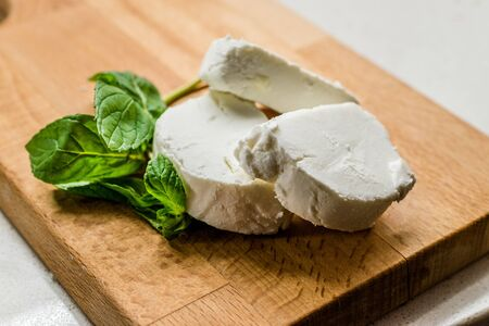 Goat Cheese Slices on Wooden Board. Ready to Eat. Organic Food. 写真素材
