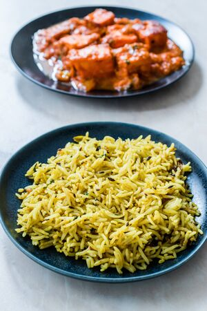 Indian Food Jeera Zira Rice Basmati Pilaf or Pilav with Paneer Butter Tikka Masala / Cheese Cottage Curry. Organic Food.