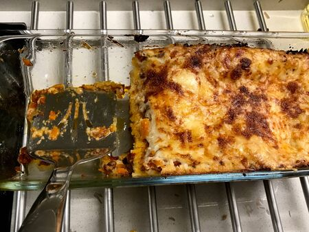 Homemade Traditional Italian Meat Lasagna in Rectangular Glass Bowl Ready to Serve and Eat. Фото со стока - 134227733