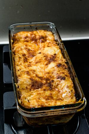 Homemade Traditional Italian Meat Lasagna in Rectangular Glass Bowl Ready to Serve and Eat.