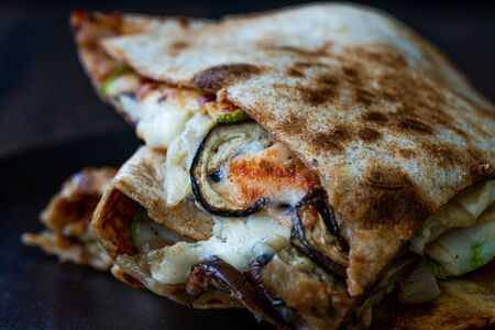 Veggie Italian Closed Calzone Pizza Slices with Mushrooms. Traditional Fast Food.