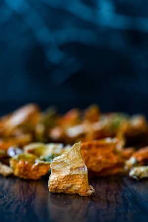 Colorful Dry Pepper Slices  Sun Dried Mixed Sliced Style Ready to Use on Wooden Surface. Organic Food.