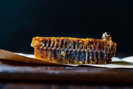 Karakovan Honeycomb / Dark Black Organic Turkish Honey. Ready to Eat. Reklamní fotografie