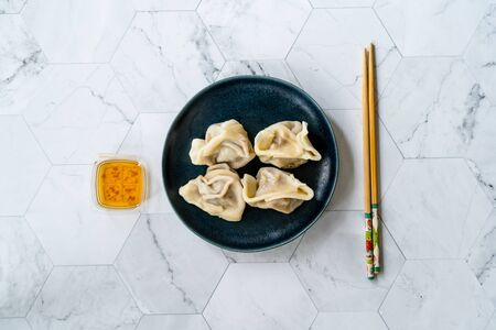 Homemade Steamed Asian Dumplings with Garlic Sauce. Ready to Eat. Stock Photo - 136642941