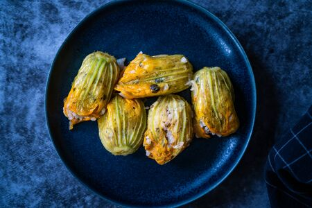 Zucchini Flowers Dolma Stuffed with Rice Pilaf / Turkish Food in Plate. Traditional Organic Food. Banco de Imagens - 137487962