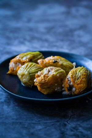 Zucchini Flowers Dolma Stuffed with Rice Pilaf / Turkish Food in Plate. Traditional Organic Food.