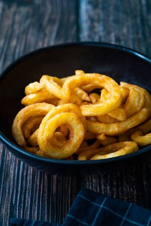 Spicy Seasoned Curly Fries Ready to Eat with Sauce. Fast Food. Stock Photo