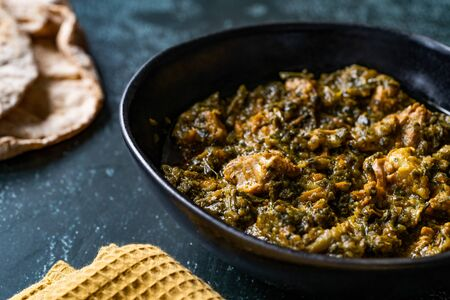 Indian Dish Spinach Lamb Palak with Chappati Flat Bread.