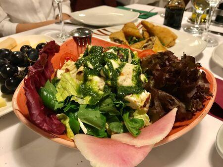 Goat Cheese Salad with Green Pesto Sauce, Purple Lettuce and Radish in Local Italian Restaurant. Organic Fresh Food. Imagens