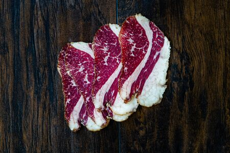 Raw Smoked Dry Aged Veal Rib Slices.  Slim Sliced and Cut Ham / Salami. Ready to Eat.