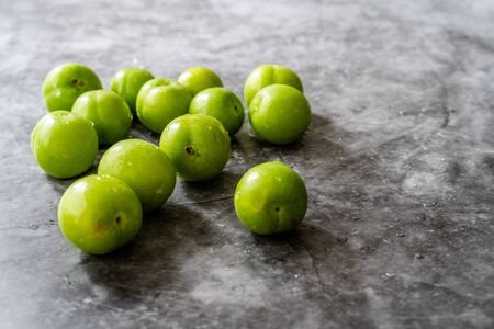 Raw Organic Sour Green Plums Ready to Eat. Healthy Food.